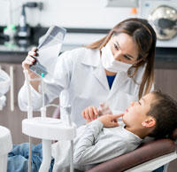 Little boy with dentist
